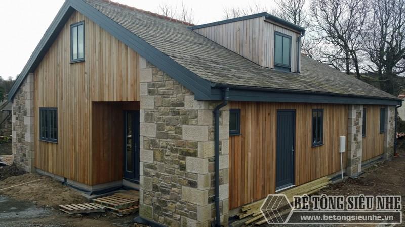 Nhà khung thép 1 tầng kết hợp tường gỗ hiện đại